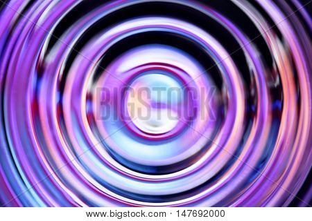 Abstract background with blue defocused concentric circles