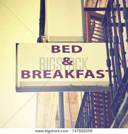 Bed and breakfast hotel sign. Retro style filtred image