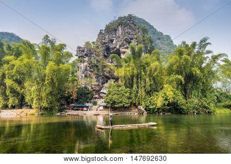 Chuanyan China - October 22 2013: The limestones hill at vicinity of the Banyan Tree Park at Chuanyan Village Yangshuo County China.
