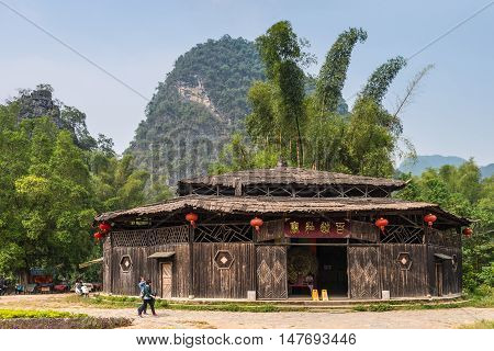 Chuanyan China - October 22 2013: Wooden Building at the Banyan Tree Park at Chuanyan Village Yangshuo County China.