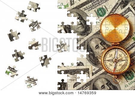 Puzzle Antique compass over 100 dollar bills background