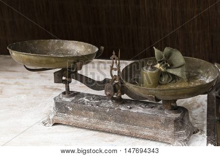 old scale for weighing their balances in a market