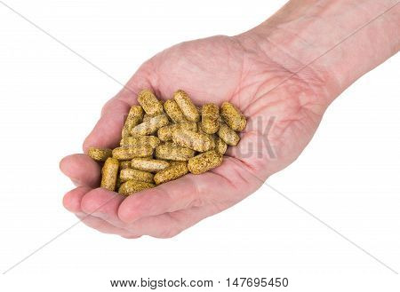 Handful Of Brown Spotted Vitamins In Male Hand