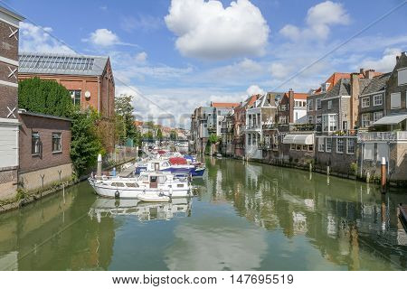 NETHERLANDS - DORDRECHT - MEDIA SEPTEMBER 2016: Canal in Dordrecht with canal houses and boats.