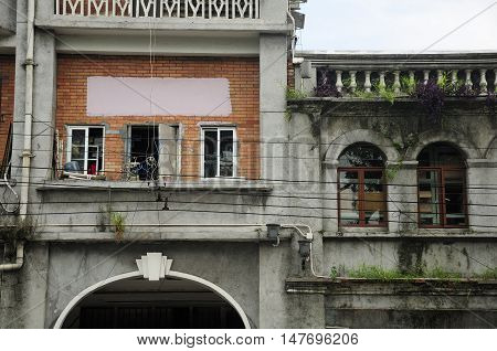 Very old and weathered buildings in the city of Guangzhou China in Guangdong province.