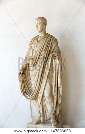 ROME, ITALY - JUNE 12, 2015: Ancient statue of man in baths of Diocletian (Thermae Diocletiani) in Rome. Italy