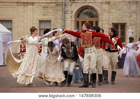 GATCHINA, ST. PETERSBURG, RUSSIA - SEPTEMBER 10, 2016: Actors in retro costumes dancing in the show in front of Gatchina palace during the festival Gatchinskaya Byl. The festival is held first time