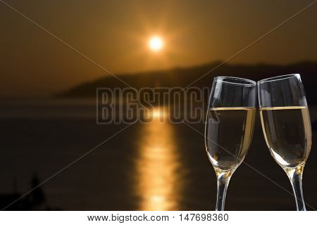 Champagne glasses on tropical beach - exotic New Year