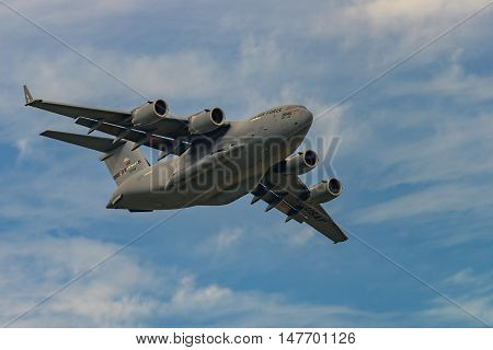 NEW WINDSOR NY - SEPTEMBER 3 2016: Giant C-17 Globemaster III taking off at Stewart International Airport during the New York Airshow.