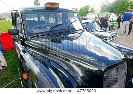 Kharkiv Ukraine - May 22 2016: Close up of retro taxi car black Ostin FX-4 manufactured in 1970 is presented at the festival of vintage cars Kharkiv Retro Rally - 2016 in Kharkiv Ukraine on May 22 2016