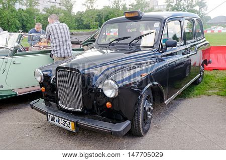Kharkiv Ukraine - May 22 2016: Retro taxi car black Ostin FX-4 manufactured in 1970 is presented at the festival of vintage cars Kharkiv Retro Rally - 2016 in Kharkiv Ukraine on May 22 2016