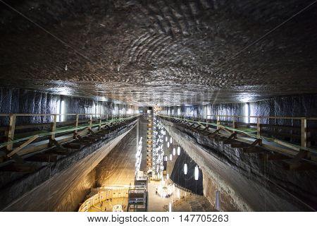 TURDA, ROMANIA - SEPTEMBER 15, 2016. Underground salt mine in Turda ,popular attraction for many tourists,Transylvania, Romania.