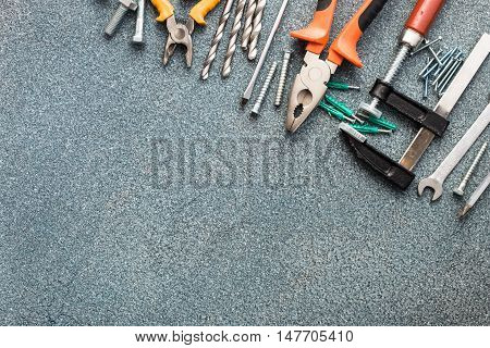 Set of tools over gray stone texture background