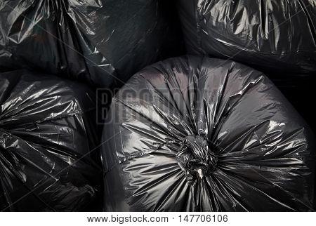 Black garbage bags as background. Black garbage bags.