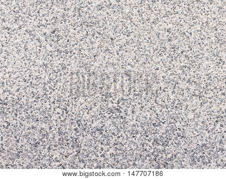 uneven mottled matt gray surface of fine granite gravel