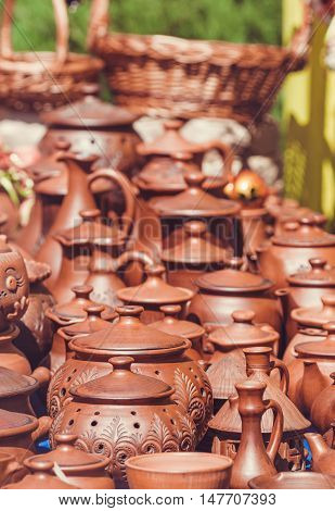Souvenir pottery on market stand. Outdoor shot. Toned