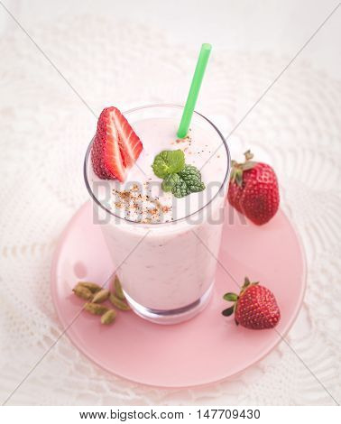 Strawberry lassi with some berry top view