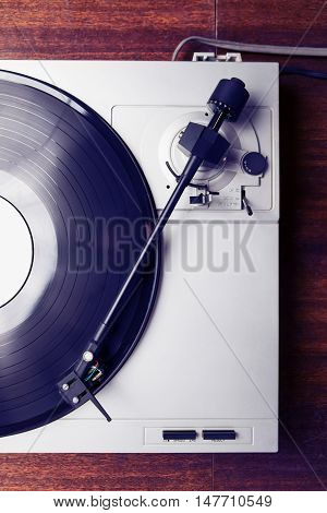 Hipster Style Turntable Playing Vinyl Record With Music