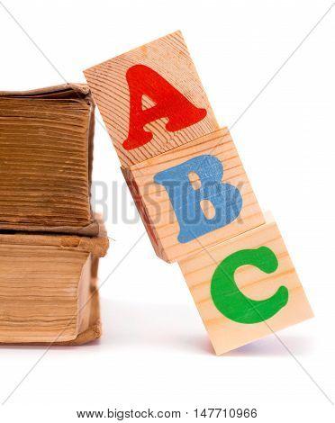 Alphabet letter ABC blocks for kids on old books isolated on white