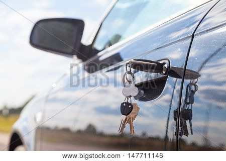 a car key on a car lock