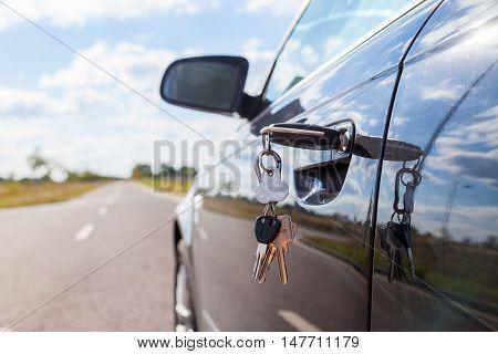 a car key on a car lock