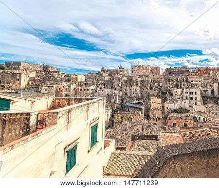 Panoramic View Of Typical Stones (sassi Di Matera) Of Matera Under Blue Sky