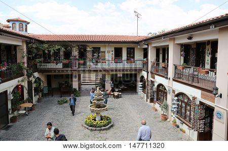 ESKISEHIR TURKEY - SEPTEMBER 03 2016: People shopping in Atlihan handicrafts bazaar. Atlihan was built in 1850 as caravanserai.