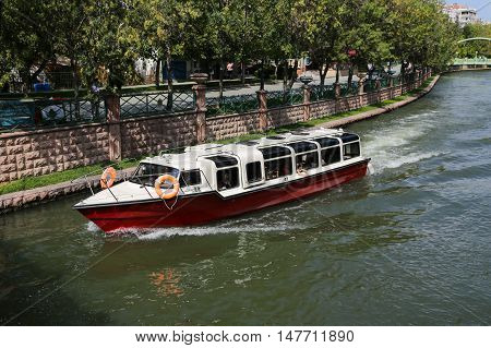 ESKISEHIR TURKEY - SEPTEMBER 03 2016: Boat tour in Porsuk river. Porsuk river is one of the most populer touristy place with boat tours and entertainment in Eskisehir.