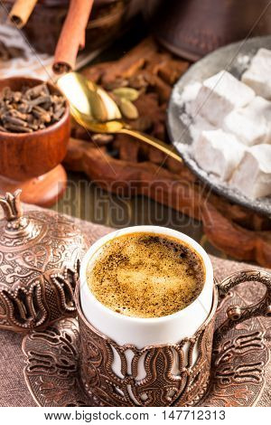 Traditional turkish coffee on table above. Embossed metal cup
