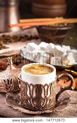Traditional turkish coffee on table. Embossed metal cup