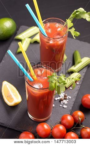 Two glasses of Bloody Mary cocktail drink above