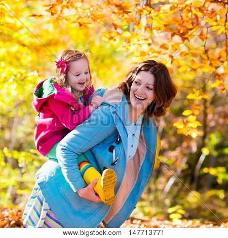 Mother And Child In Autumn Park