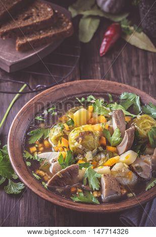 Vegetable and mushroom stew rustic style dark toned