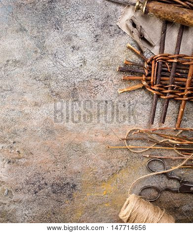 Vine weaving items from right side of old rusty metal background with copy space