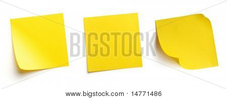 Yellow blank post-it notes isolated on white