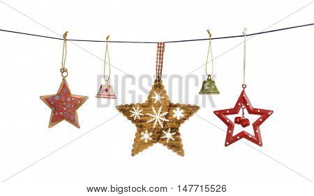 Vintage Christmas stars and bells hanging on string isolated on white background