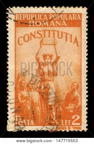 ROMANIA - CIRCA 1948: A stamp printed in Romania shows allegorical image of the new Constitution, series new constitution, yellow orange, circa 1948