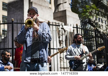 Buenos Aires Argentina - October 4 2013: Street musicians playing in a street in the city of Buenos Aires in Argentina