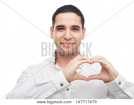 happy smiling young man showing a sign of a heart with his fingers, isolated against white studio