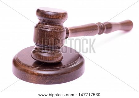 Wooden gavel isolated on white background closeup
