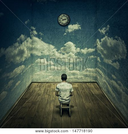 Abstract idea with a person sitting in a dark room in front of a clock surrounded by limitations daily routine concrete walls with clouds texture. Time pressure deadline concept