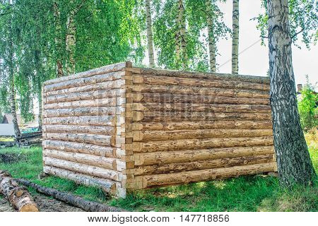 construction of a new wooden house log cabin on summer