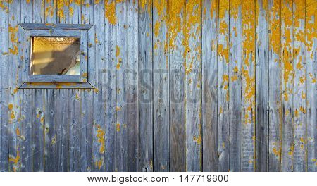 Window and wall of a vintage wood house