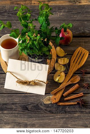 Still Life Of Wooden Utensils With Mint And Apples