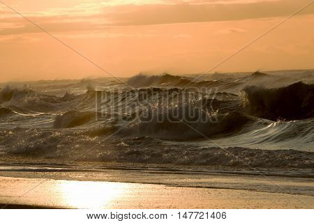 Large and rough waves at sunrise as hurricane hermene sits off shore