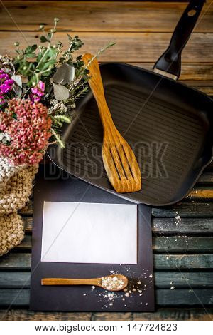 Still Life On A Wooden Table With  Grill Pan And  Utensils