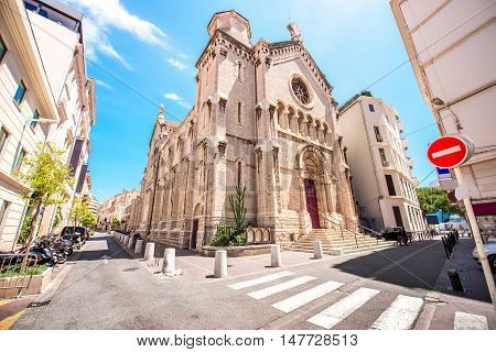 Street view with Notre-Dame de Bon Voyage church in Cannes in France