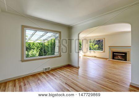Open Floor Plan Empty Living Room With Polished Hardwood Floor.