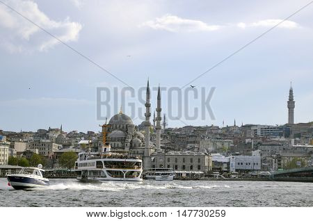 Istanbul Turkey - April 18 2014: New Mosque (Yeni Cami) Istanbul Turkey. The Yeni Cami ; originally named the Valide Sultan Mosque and later New Valide Sultan Mosque after its partial reconstruction and completion between 1660 and 1665; is an Ottoman impe