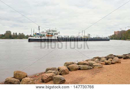 Cargo ship on the Neva river outskirts of St.Petersburg Russia.